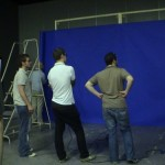 Art Department contemplate blue screen made of paper